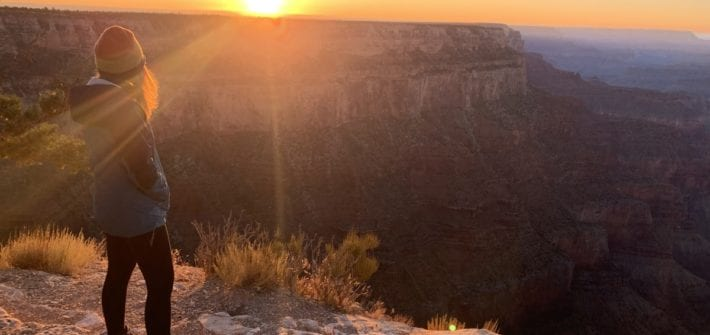 Woman watching Grand Canyon Sunset